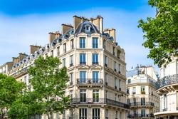 Paris, typical building, parisian facade wall and windows boulevard de Sebastopol