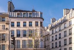 Paris, typical facade and windows, beautiful building in Montmartre, with old zinc roofs