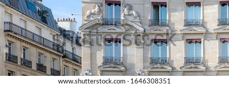 Paris, typical facades and windows, beautiful buildings in Montmartre, with horses carved on the façade