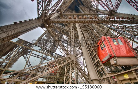 Paris. Unusual Eiffel Tower lifts that take passengers to the viewing platforms. They are located on the legs of the tower and follow the curvature of the structure. #155180060