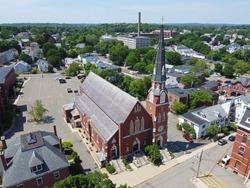 Parish of St. John the Baptist Church aerial view at 17 Chestnut Street in downtown Peabody, Massachusetts MA, USA.