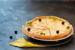 Parisian Flan, cutted classic tart decorated with blueberry served on a tray copy space