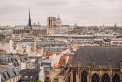 Parisian urban landscape with a fountain Pompidou, the Church of Saint-Merri, Notre-Dame Cathedral and the Tower of Saint-Jacques.