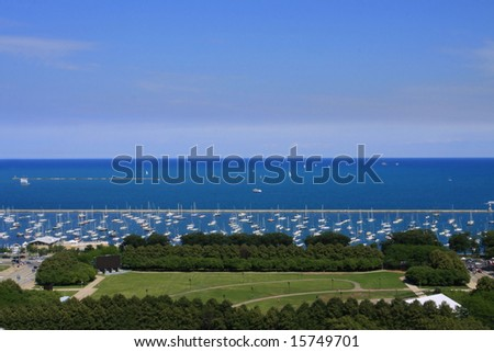 Park and Harbor with Sailboats