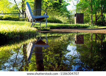Park bench and water. #1186304707