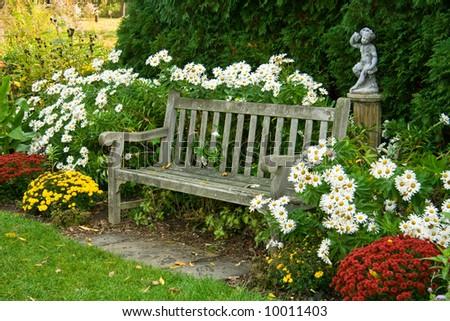 Park bench in arboretum - stock photo