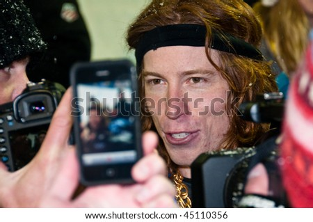 PARK CITY, UT - JANUARY 22: Shaun White with the press with a fan taking his picture with an iPhone at the US Snowboarding Grand Prix on January 22, 2010 in Park City, Utah. - stock photo