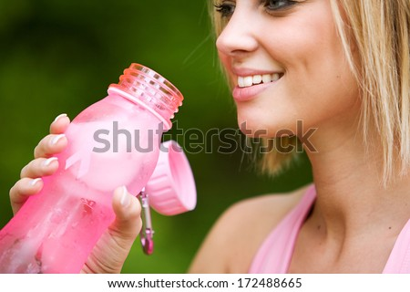 Park: Girl taking A Drink From Pink Water Bottle