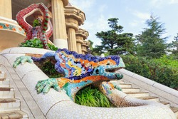 Park Guell in Barcelona. Frog sculture fountain at main entrance covered with pieces of colorful ceramic tile