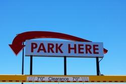 Park Here Underground Parking Sign