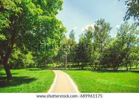 Park in the city center in bright sunny summer weather - Shutterstock ID 689961175