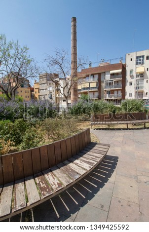 Park of the city of Barcelona in the neighborhood of Sants. Ancient fireplace of what had been a textile factory. History. #1349425592