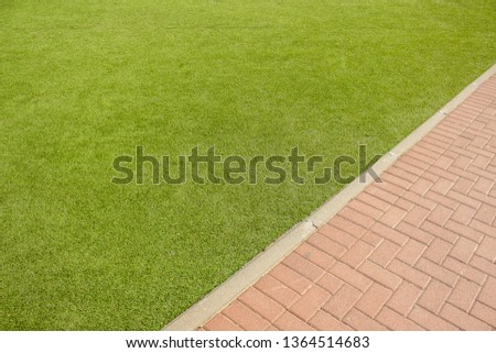 park outdoor aerial exterior wallpaper pattern with diagonal board between green grass and brown brick paved road background textured surfaces with empty copy space for your text #1364514683