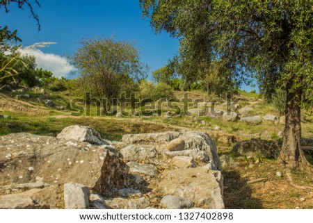 park outdoor nature wilderness outskirts environment with foreground stone ruin object in clear bright summer colorful season weather time #1327402898