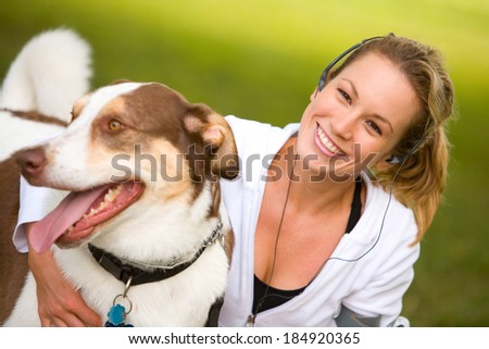 Park: Smiling Woman With Panting Dog In Park
