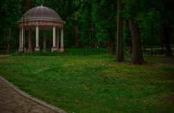 park walking alley for promenade with column gazebo architecture object in cloudy dramatic weather time without people