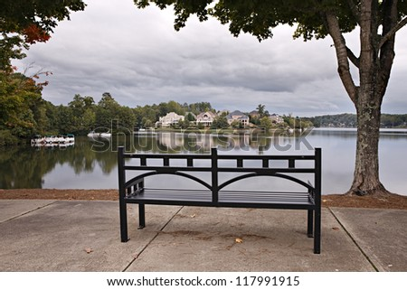 Park with bench, trees and lake
