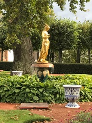 Park with golden statue in Petergof