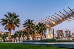 Park with Palm Trees on Palmeral de las Sorpresas Architecture Landmark in Evening Lights Malaga, Spain