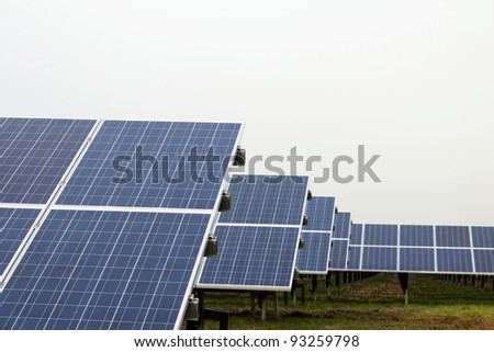 Park with solar cells in front of a overcast sky