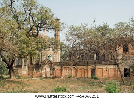 Park with structures of Lucknow Residency built in mughal style in India. Residency took place between 1780 to 1800, served as residence for British Resident General #464868251