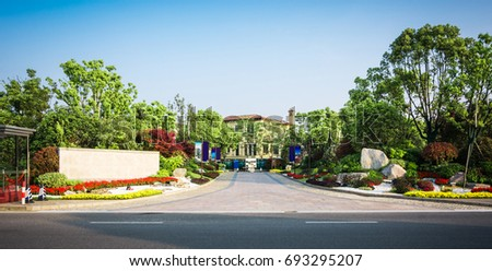 Park with trees and fountains in front of the Business Center #693295207