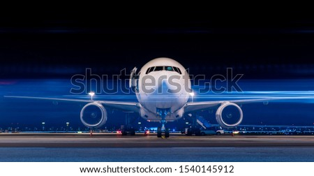 Parked aircraft in night with moving light Stock photo ©