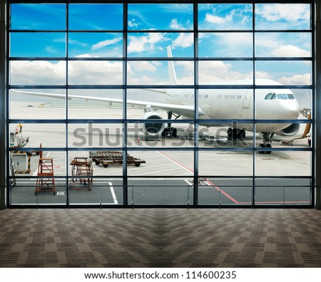 Parked aircraft on shanghai airport through the gate window.