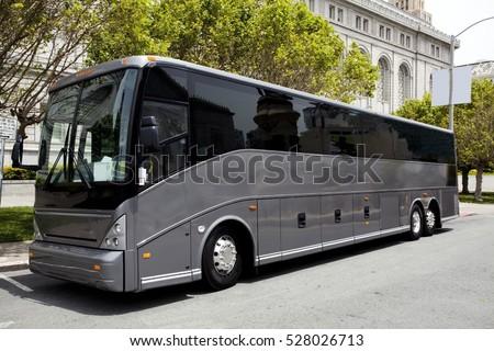 Parked black tour / charter bus in San Francisco. Horizontal.