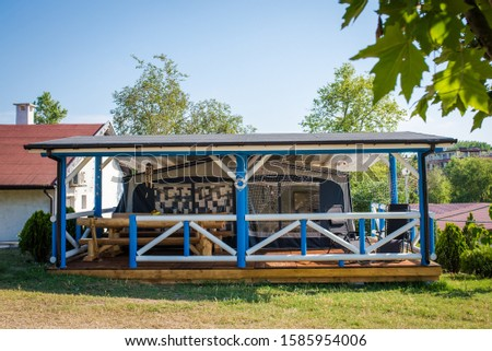 Parked caravan with a terrace in a caravan resort/camping. Summer recreation conept