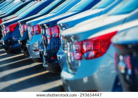 Parked Cars on a Lot. Row of New Cars on the Car Dealer Parking Lot. Cars Market Theme.