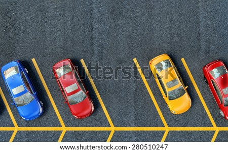 Shutterstock Parked cars on the parking. One place is free
