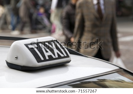 Parked taxi car roof detail, selective focus on taxi sign