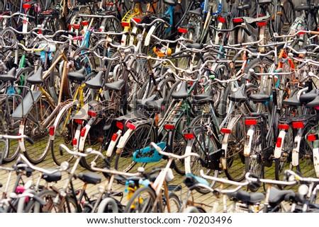Parking bikes in Amsterdam,Netherlands,shallow focus - stock photo