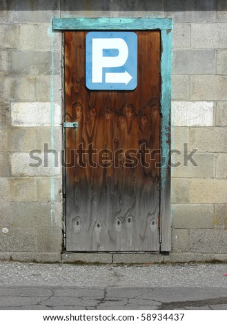 Parking directions sign on old wooden door