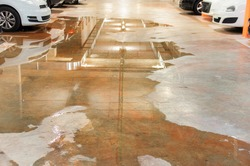 Parking flooded with water due to external leaks