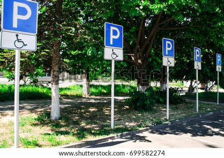 Parking for the disabled. Road signs. Symbol. #699582274