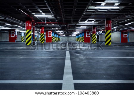 Parking garage underground, industrial interior.  Neon light in bright industrial building.