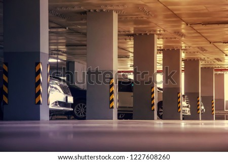 Parking in a residential building. Covered underground parking for cars