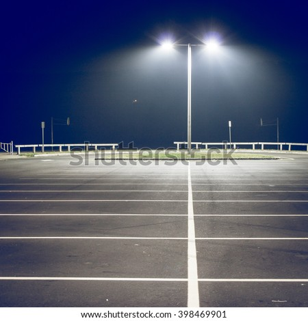 Parking lot with street light at night, filtered image
