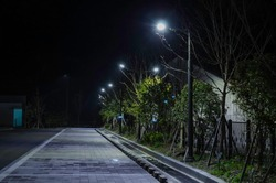 Parking lot with streetlight in night.