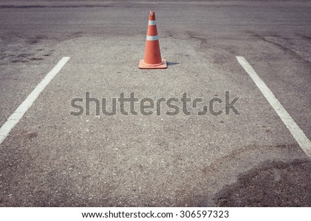 parking lot with traffic cone...