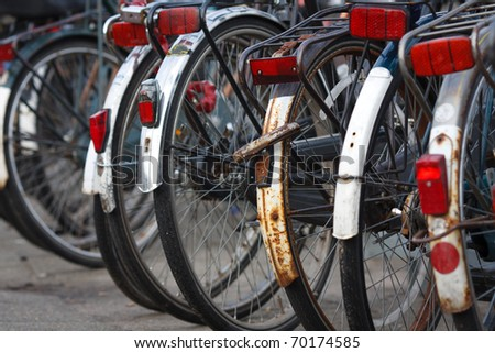 Parking of old bicycles in Amsterdam,closeup,shallow focus