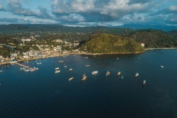 parking of ships.city port.Wild islands of Indonesia. Flores tropical paradise. Labuan Bajo. drone shooting. Wild beaches, blue logons, coral reefs, green hills. aerial view. boat trip safari. harbor
