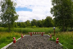 Parking place for special vehicles near a fire pond in a natural park in Ukraine. Board, empty space for inscription. No parking zone.