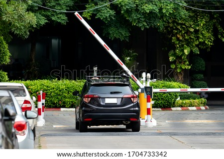 Parking place of the building, with automatic barrier system   Foto stock ©