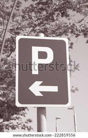 Parking Sign in Urban Setting in Black and White Sepia Tone