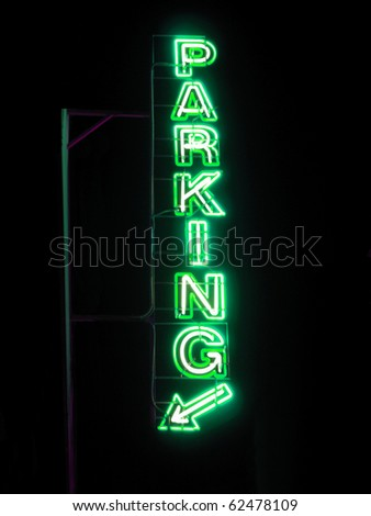 Parking sign neon light at night over dark sky - stock photo