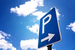 parking sign with blue sky and clouds