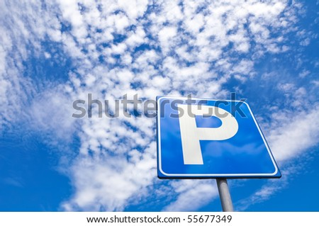 Parking signal in the blue sky